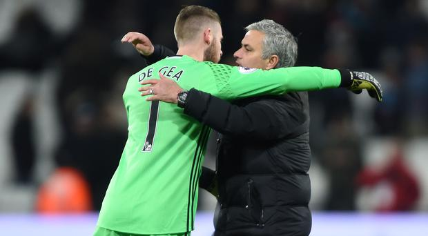 Jose Mourinho, right, does not think David De Gea will be poached by Real Madrid
