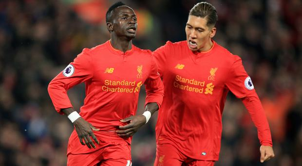 Sadio Mane, left, scored twice as Liverpool saw off Tottenham