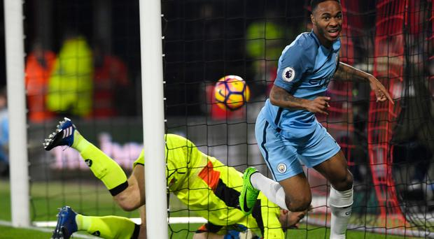 Raheem Sterling wheels away after giving Manchester City the lead Picture: Getty