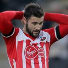 Charlie Austin has admitted his role in a road crash which injured a cyclist