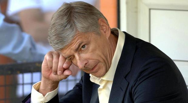Arsenal manager Arsene Wenger, pictured, should step down, according to Frank McLintock