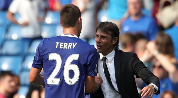 Chelsea head coach Antonio Conte and John Terry. Photo: PA