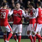 Forward Lucas Perez (centre) feels comfortable at Arsenal following his summer move from Spain