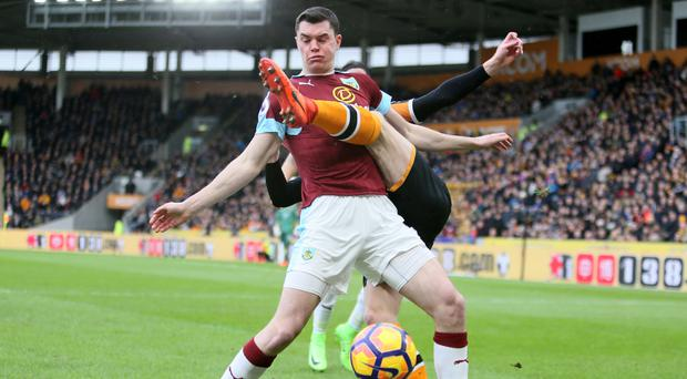 Burnley's Michael Keane gets in a tangle during an eventful match for the defender