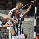 Gareth McAuley, front, scored West Brom's winner on his 500th club appearance