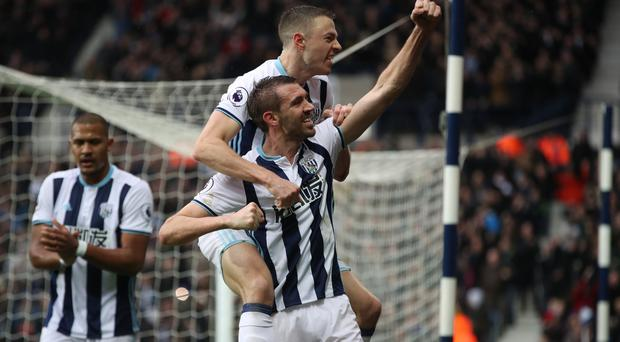 Gareth McAuley celebrates his goal against Bournemouth