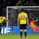 Watford's Troy Deeney scores his side's first goal of the game during the Premier League match at Vicarage Road, Watford.