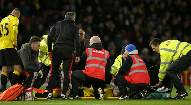 Watford's Mauro Zarate, pictured receiving treatment for his injury, has damaged the cruciate ligament in his knee