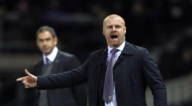 Swansea head coach Paul Clement, left, and Burnley boss Sean Dyche have been familiar foes down the years