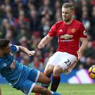 Luke Shaw, right, was restored to the Manchester United starting line-up against Bournemouth