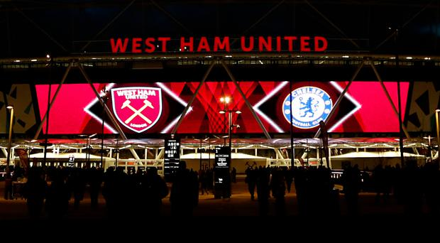 A West Ham supporter who ran on to the pitch has been arrested and will appear in court later this month