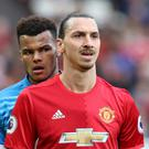 Tyrone Mings, left, and Zlatan Ibrahimovic