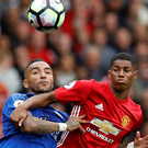 Manchester United's Marcus Rashford battles against Leicester City's Danny Simpson earlier this season