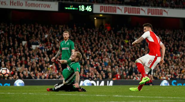 Arsenal's Olivier Giroud scores their second goal of the game against Lincoln City. Photo: Reuters