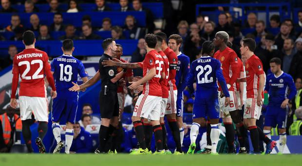 Manchester United's players harangue Michael Oliver following Ander Herrera's dismissal