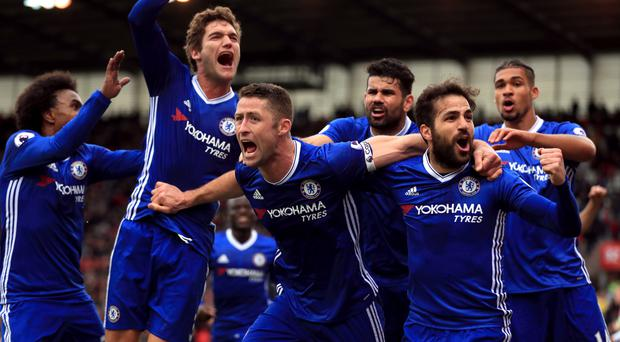 Gary Cahill, centre, celebrates Chelsea's winner