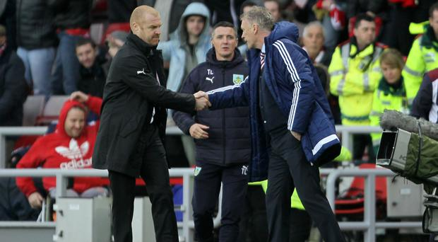 Sean Dyche (left) and David Moyes shake hands after a frustrating afternoon for both