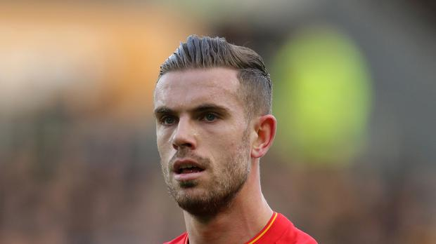 Liverpool captan Jordan Henderson has travelled to the squad's Tenerife training camp as he continues his recovery from injury.