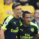 Alexis Sanchez, right, and Mesut Ozil, left, have 15 months remaining on their contracts at Arsenal