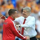 Lukas Podolski, pictured left, has spoken highly of Arsenal boss Arsene Wenger