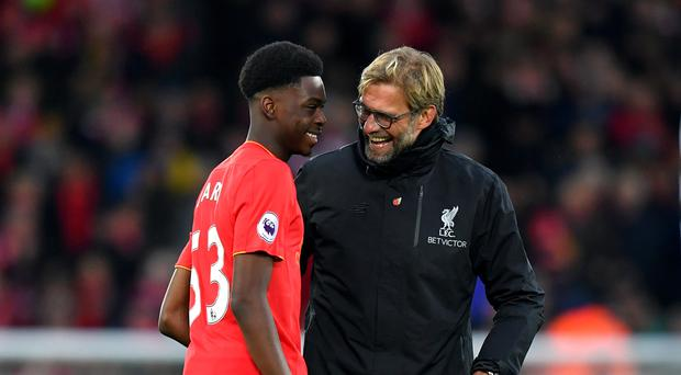 Liverpool manager Jurgen Klopp believes Ovie Ejaria (left) should be a role model for aspiring youngsters at the club's Tenerife training camp.