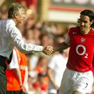 Robert Pires, right, won two Premier League titles at Arsenal under Arsene Wenger