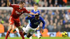 Jamie Carragher, left, was not afraid to put in a challenge during his playing days