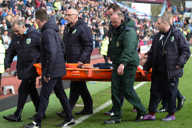 Harry Winks was carried off on a stretcher at Turf Moor. Photo: