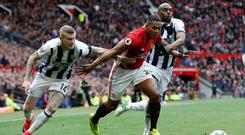 James McClean combines with Allan Nyom to bottle up Antonio Valencia at Old Trafford Photo: Reuters / Andrew Yates