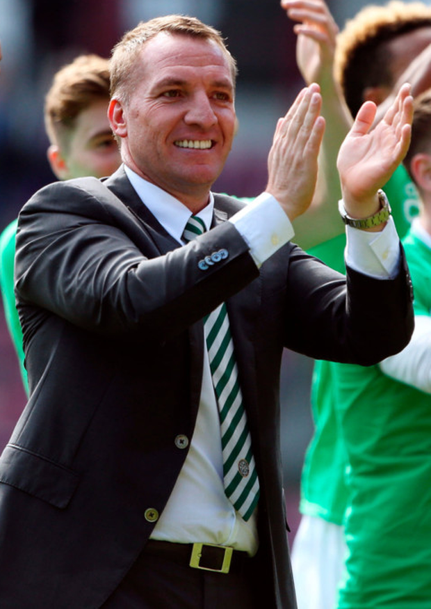 Celtic manager Brendan Rodgers celebrates after the match Photo: PA