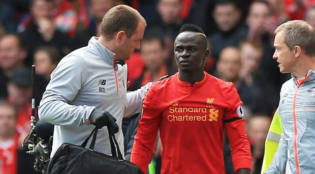 Liverpool's Sadio Mane leaves the pitch after picking up an injury against Everton