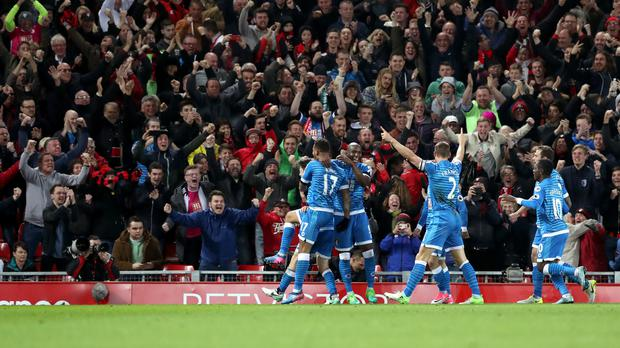 Bournemouth's players celebrate their late leveller