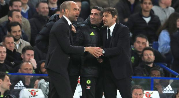 Antonio Conte, right, got the better of Pep Guardiola, left, again