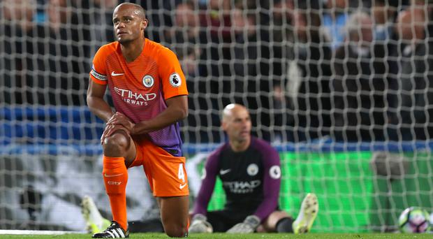 Manchester City captain Vincent Kompany wants his side to secure Champions League qualification and a place in the FA Cup final