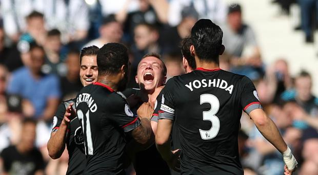 Southampton's Jordy Clasie is mobbed by his team-mates after scoring the winner