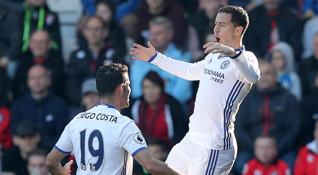 Eden Hazard, right, has admitted he knew he would score ahead of firing one of Chelsea's three goals in the 3-1 Premier League win at Bournemouth