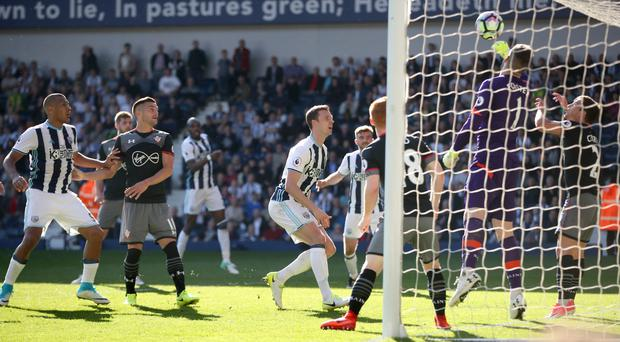 Southampton goalkeeper Fraser Forster saves from Jonny Evans in injury time in their 1-0 win at West Brom