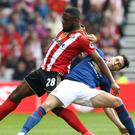 Sunderland's Victor Anichebe, left, is refusing to give up on Premier League survival