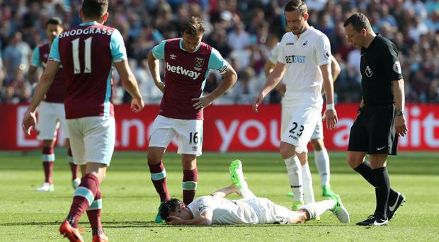 Jack Cork is battling to be fit for Swansea's Premier League clash with Watford on Saturday