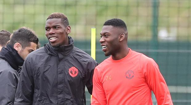 Manchester United's Paul Pogba, left, has commented on the size of his transfer fee