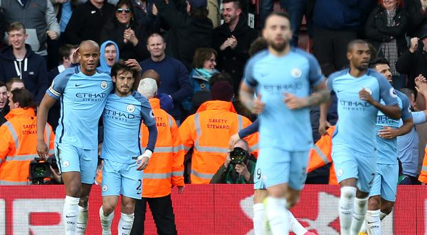 Manchester City's Vincent Kompany, left, celebrates scoring his side's first goal of the game against Southampton