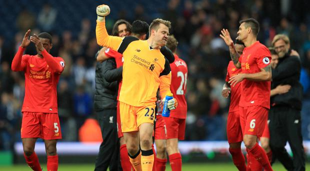 Liverpool goalkeeper Simon Mignolet celebrates after their 1-0 win at West Brom on Sunday