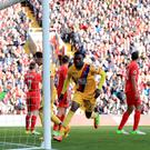 Christian Benteke, centre, bagged a brace at Liverpool