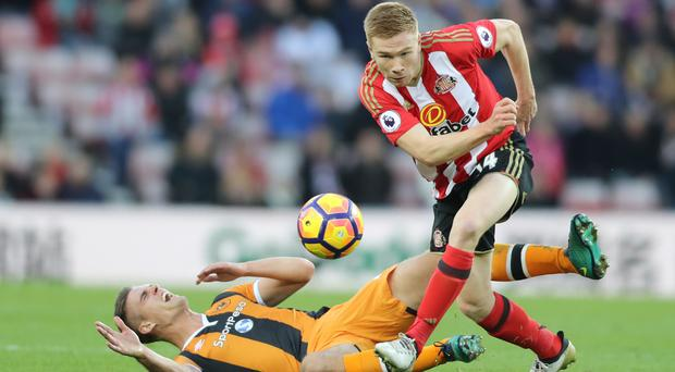 Sunderland striker Duncan Watmore, right, could require a second operation on his knee