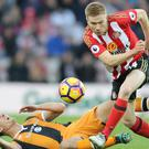Sunderland striker Duncan Watmore (right) could require a second operation on his knee