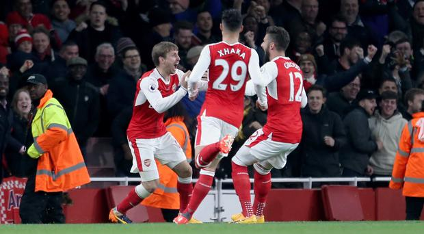 Arsenal's players celebrate Robert Huth's own goal