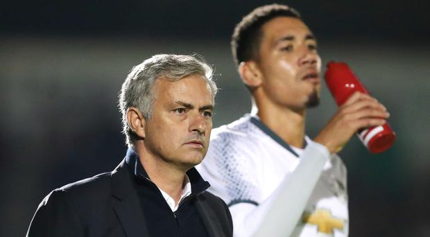 Jose Mourinho, left, insists Chris Smalling, right, and Phil Jones will get a chance next season