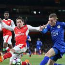 Arsenal's Hector Bellerin, pictured challenging Leicester's Jamie Vardy, says there is a good mood in the Gunners' camp