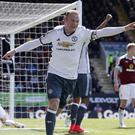 Wayne Rooney scores in the win over Burnley