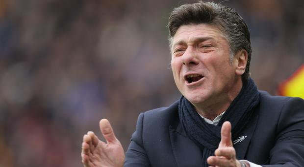 Watford manager Walter Mazzarri, pictured, feels owner Gino Pozzo would be 'happy' with the way his first season in charge has gone